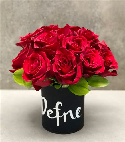 Red Roses in Black Vase